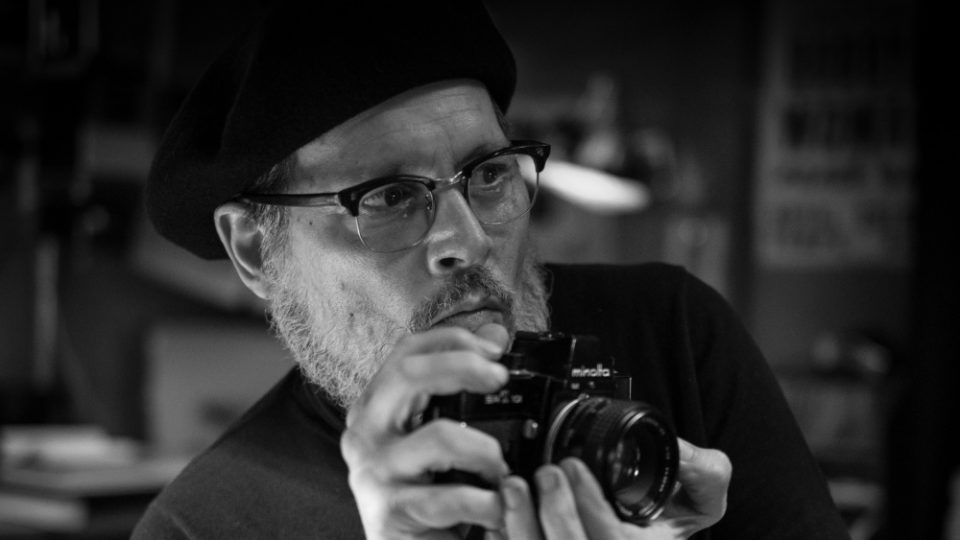 Johnny Depp unrecognizable as war photographer W. Eugene Smith
