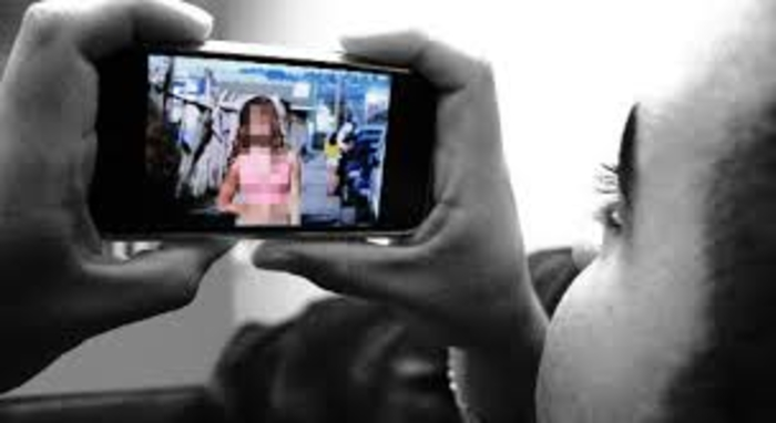 Boys blackmail 13 year old girl, threaten to share her photos online
