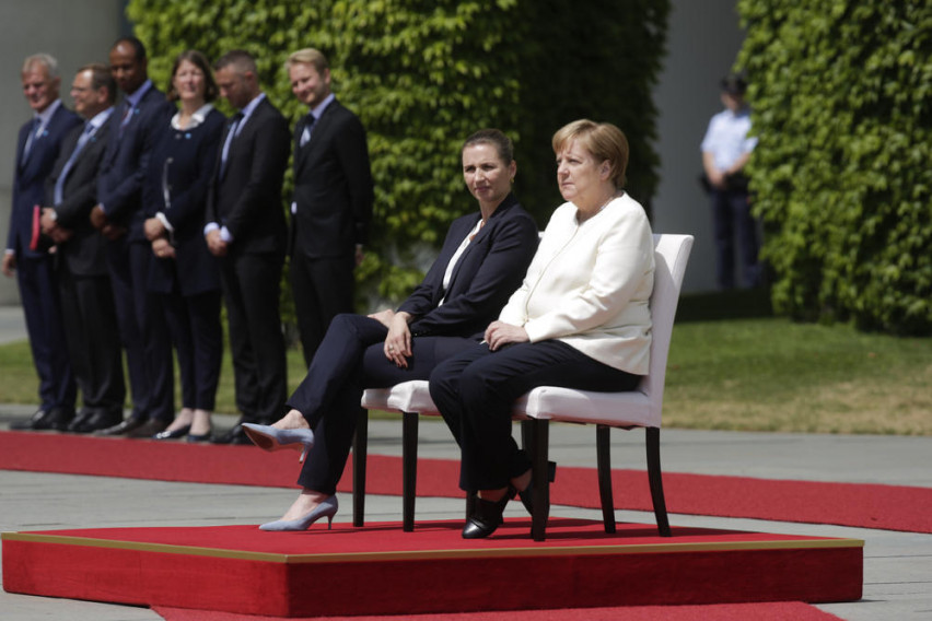 Angela Merkel sits for anthems after latest shaking episode