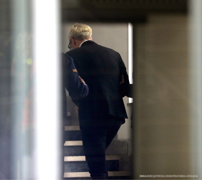 Boki 13 arrives for questioning at the Prosecutor's Office