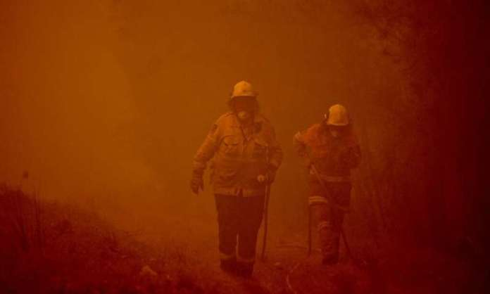 Two Aussie wildfires merge into inferno; man seriously burned