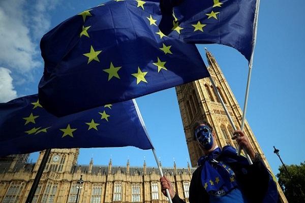 Scottish parliament demands independence vote, vows to keep EU flag