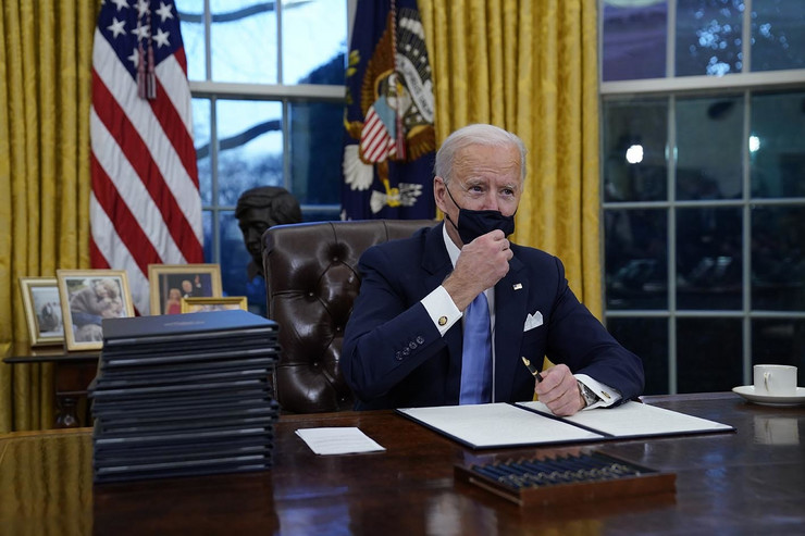 Biden marks start of presidency with flurry of executive orders