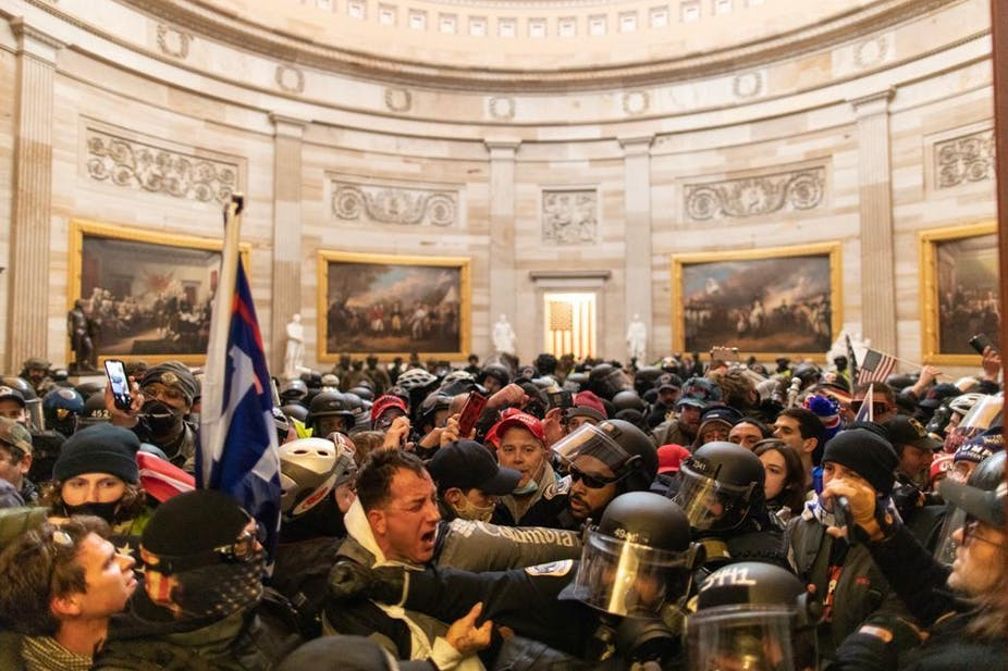 US law enforcement authorities carry out widespread arrests after storming of US Capitol
