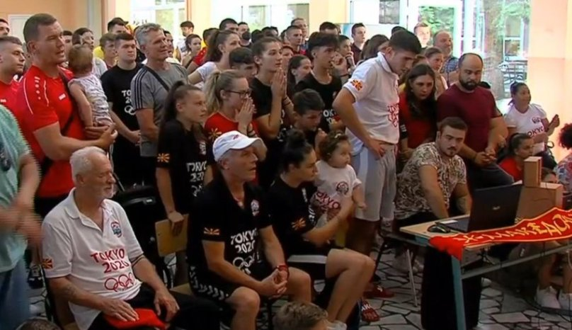 Shop closed as Georgievski's friends and neighbors gathered to watch the taekwondo final
