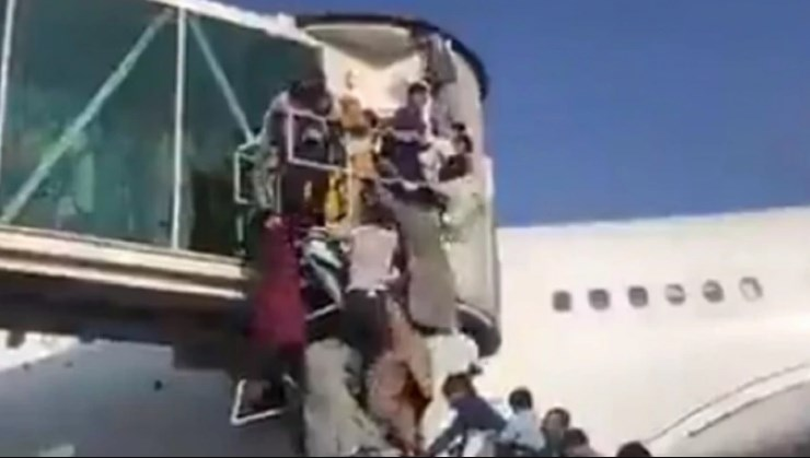 Chaos and panic at Kabul airport as Afghans and foreigners attempt to flee the capital