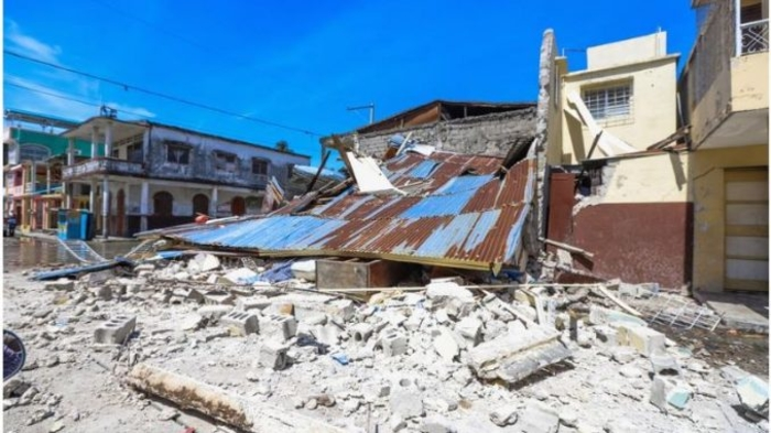 At least 304 people have died in the powerful Haiti earthquake